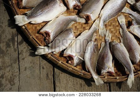 One Technique For Food Preservation. Sun Fish Raw Food On The Basketwork In Sunny Day.