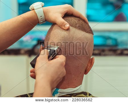 Barber Cuts Your Head Electric Razor. Man Haircut In The Barbershop.