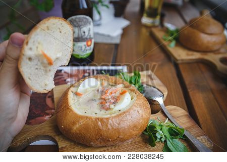 National Polish Soup Zurek In Bread. Traditional Polish Belorussian Soup Real View