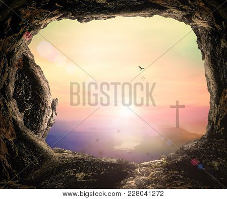 Good Friday Concept: Empty Tomb Stone And The Cross Sunset Background