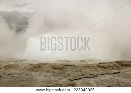 Fountain Geyser Erupting At Fountain Paint Pots In Yellowstone National Park