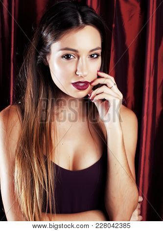 Young Pretty Girl With Night Party Makeup Posing Fashion Style On Red Curtain Background, Lifestyle