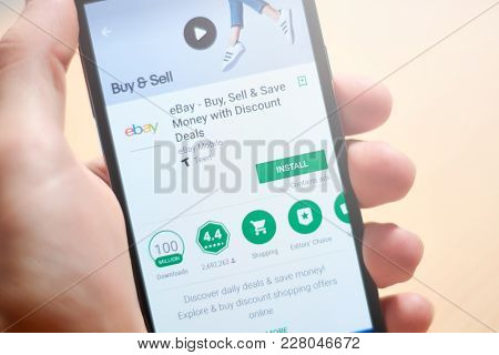 Buenos Aires, Argentina - February 22, 2018: Hand Holding A Mobile Phone Showing The Google Play App
