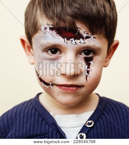 Little Cute Real Boy With Facepaint Like Zombie Apocalypse At Halloween Party Close Up, Treat Or Tre