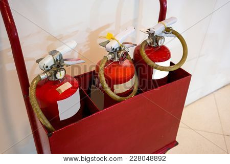 Red Fire Extinguishers In The Red Metal Cart