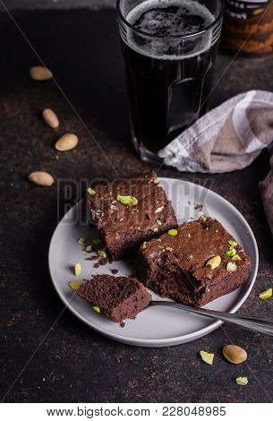Homemade Brownie On Dark Beer On Stone Table. American Classical Dessert Brownie. Use In A Recipe Of