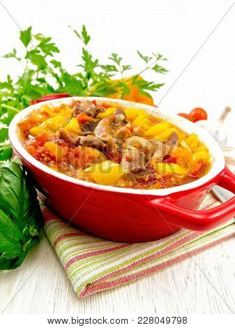 Ragout Of Turkey Meat, Tomato, Yellow Sweet Pepper And Onion With Sauce In A Brazier On A Towel Agai