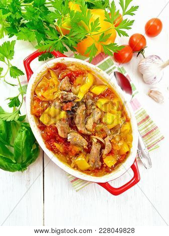 Ragout Of Turkey Meat, Tomato, Yellow Sweet Pepper And Onion With Sauce In A Brazier On A Towel On T