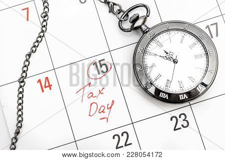 Deadline Of Pay Tax Concept. Tax Day Written On Calendar And Pocket Watch. Business Concept.
