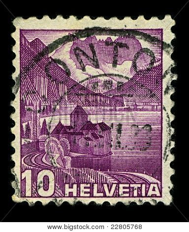 SWITZERLAND-CIRCA 1936:A stamp printed in SWITZERLAND shows image of The Chateau de Chillon (Chillon Castle) is located on the shore of Lake Leman in the commune of Veytaux, Switzerland, circa 1936.