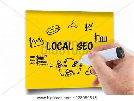 Digital composite of Local Seo graphic on a post-it. Hand with pen drawing it.