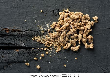 high angle view of some chunks of textured soy protein on a gray rustic wooden table
