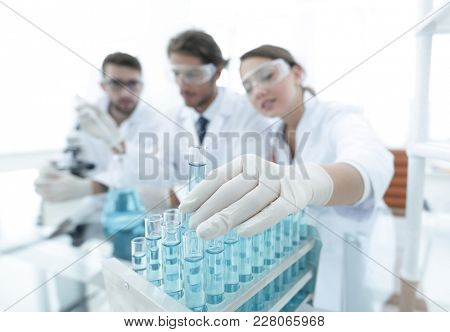 Scientist holding test tube or some equipment of science