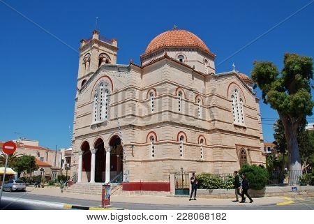 AEGINA, GREECE - APRIL 26, 2017: The domed church of Panagitsa on the seafront at Aegina Town on the Greek island of Aegina. Dating from 1673, the church was rebuilt in 1906.