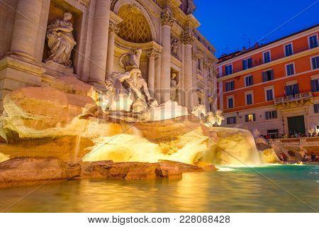 The famous Fontana di Trevi in Rome illuminated at night