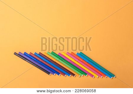 Multicolor Felt Tip Pens On Yellow Background.