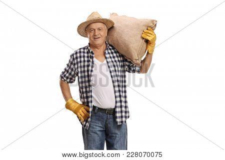 Elderly farmer holding a burlap sack isolated on white background