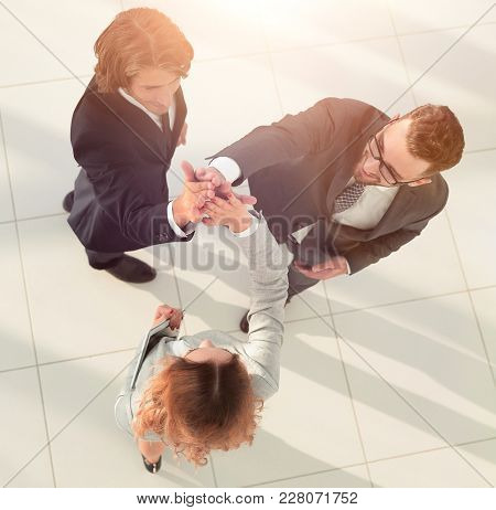 Business people giving high five staying in the office