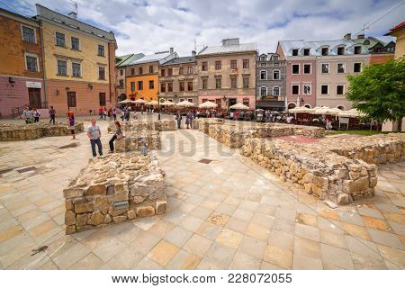 LUBLIN, POLAND - JULY 13, 2013: Old town in the city center of Lublin, Poland. Lublin is the largest Polish city east of the Vistula River with historic architecture and royal castle.