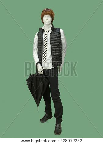 Full-length Male Mannequin Dressed In Fashionable Clothes, Isolated On Green Background.  No Brand N