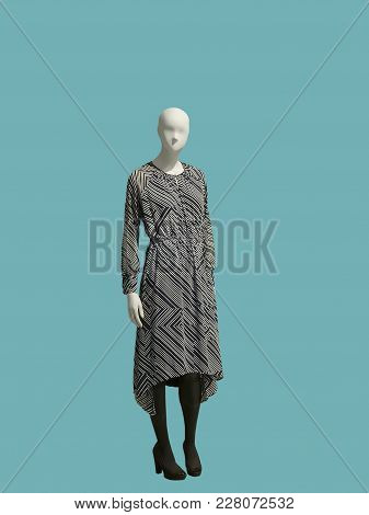 Full-length Female Mannequin Wearing Gray Dress With Geometric Pattern, Isolated. No Brand Names Or