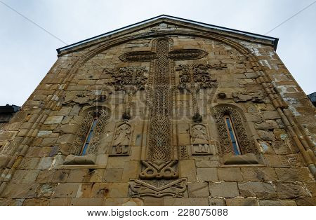 Architectural Details Of Bas-reliefs On Wall Of The Gergeti Trinity Church. Tsminda Sameba - Holy Tr