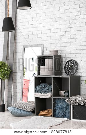 Cozy room interior with shelving unit used as wardrobe