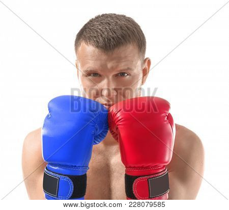 Man wearing red and blue boxing gloves on white background. Concept of political confrontation between American major parties - Democratic and Republican