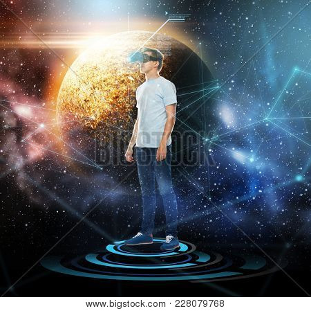 technology, augmented reality, network and people concept - young man with virtual headset or 3d glasses over planet and space background