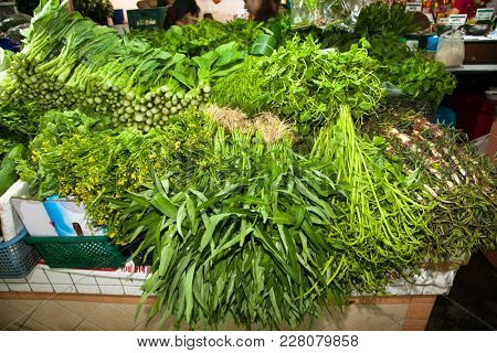 Vegetables, spices, roots and herbs on the counter, the local market in Thailand