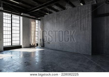 An empty, abandoned industrial concrete warehouse room with bright windows. 3d Rendering.