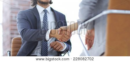 Successful job interview with boss and employee handshaking