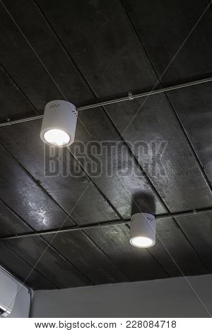 Energy Efficient Light Bulb On Ceiling, Stock Photo