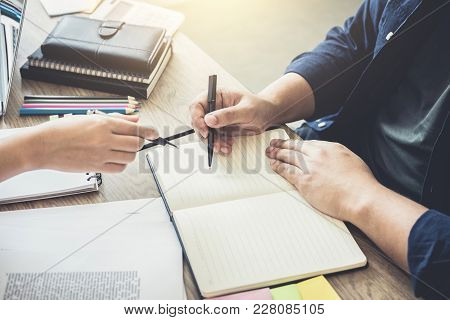 Two High School Students Campus Or Classmates With Helps Friend Studying For A Test An Exam In Workb
