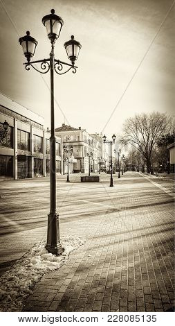 Lamps On The City Street. Astrakhan. Russia.11.02.2018. Monochrome Image. Vintage. Outdoors. Horizon