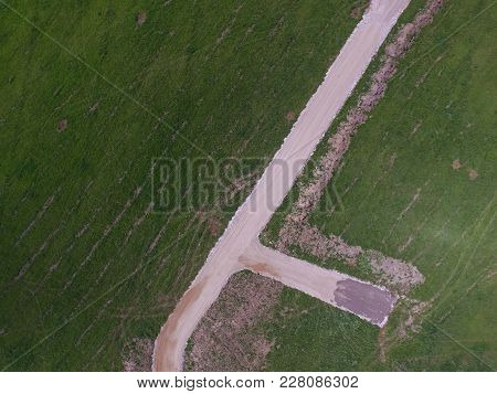 It Is Concept About Human Impact To Nature Which Is Reflected In Photo By New Gravel Road And Green