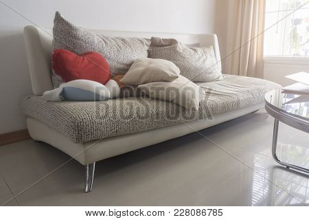 Sofa And Blanklets In The Living Room Of The House