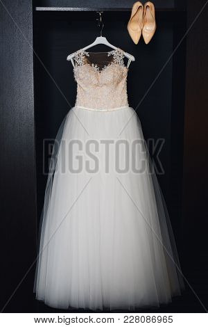 White Wedding Dress With Corset And Beige Shoes In The Hotel