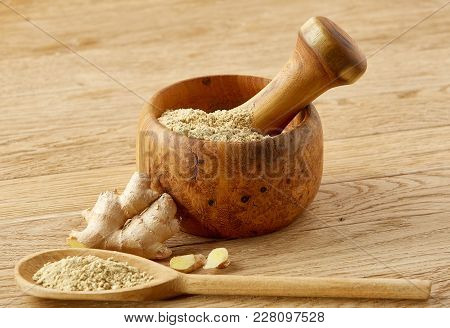 Beautiful Kitchen Still Life Wooden Mortar Full Of Grind Spicies And Pestle With Ginger And Flat Kit