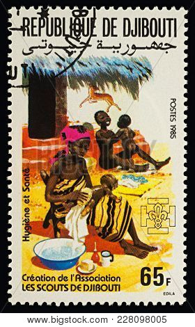 Moscow, Russia - February 22, 2018: A Stamp Printed In Djibouti Shows Young African Woman Washing Ba