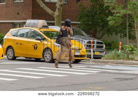 New York City, Usa - June 08, 2017: New York Yellow Taxi Cab Stop At Pedestrians Traffic Lights Cros