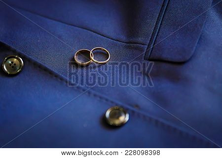 Wedding Golden Rings On A Blue Jacket