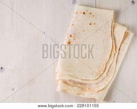 Armenian Flat Bread Lavash. Pita Bread On White Wooden Table. Copy Space. Top View Or Flat-lay.