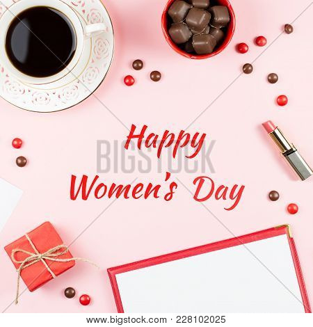 Happy Womens Day Greeting Card With Giftbox, Sweets, Black Coffee And Red Lipstick In Background.