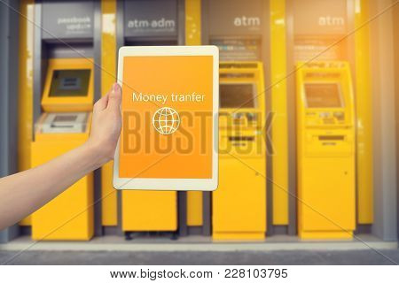 Human Hand Hold And Scanning Fingerprint On Smart Phone , Tablet, Cellphone With Transfer Money Mess