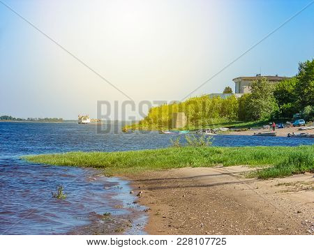 River Embankment In A Small Town, Summer Day