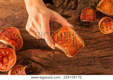 Hands Hold Bael Fruit