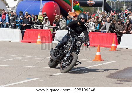 Minsk, Belarus - April 24, 2016 Hog. Harley Owners Group Opening Driving Season Show. Man Riding Wit