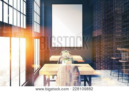 Brick And Black Loft Bar Interior With A Concrete Floor, A Bar With Stools And Wooden Tables With Ch