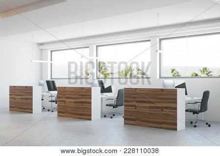 Modern Office Corner With A Concrete Floor, Wooden Columns And Cubicles With Computer Tables. 3d Ren